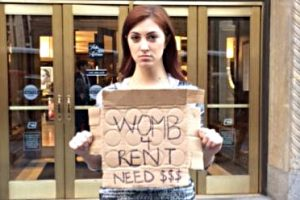 "woman holding ""Womb 4 Rent Need $$$"" sign"